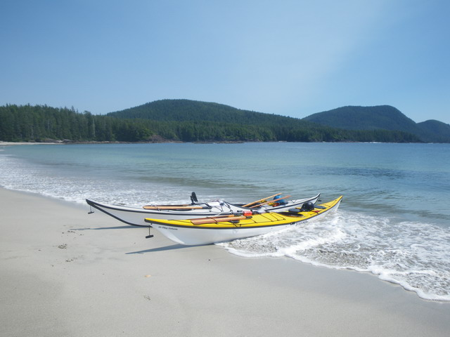 Kayaks on beach at Grant Bay.jpg